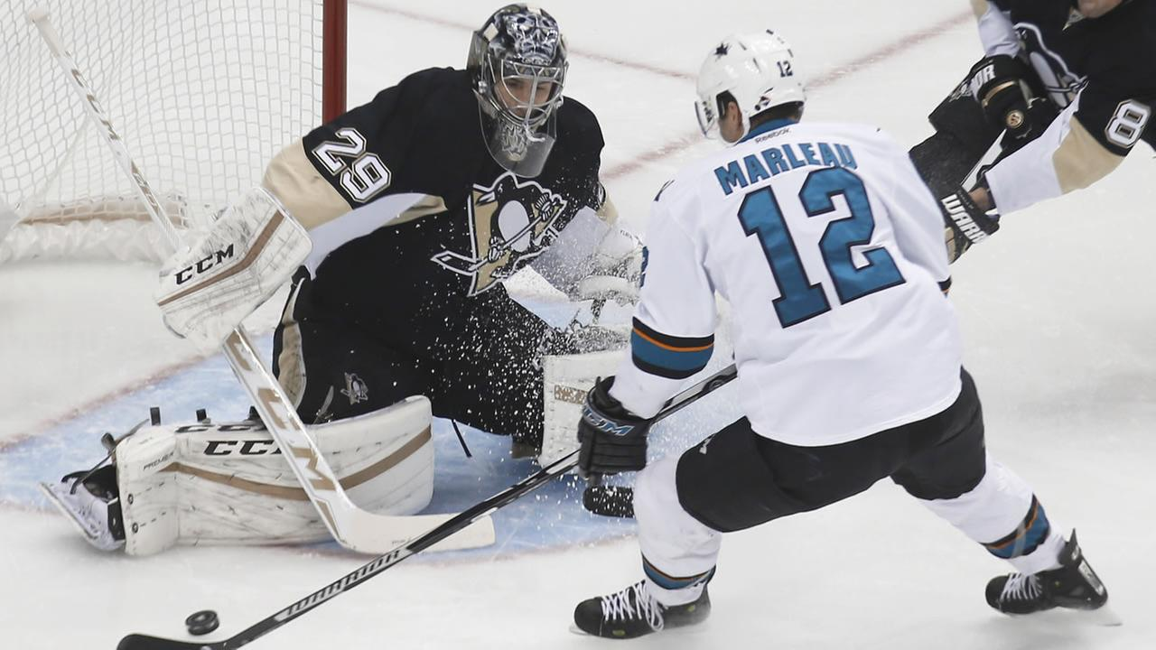 Patrick Marleau is stopped by Pittsburgh Penguins goalie Marc-Andre Fleury while shooting in the first period of an NHL hockey game, Saturday, Nov. 21, 2015, in Pittsburgh.