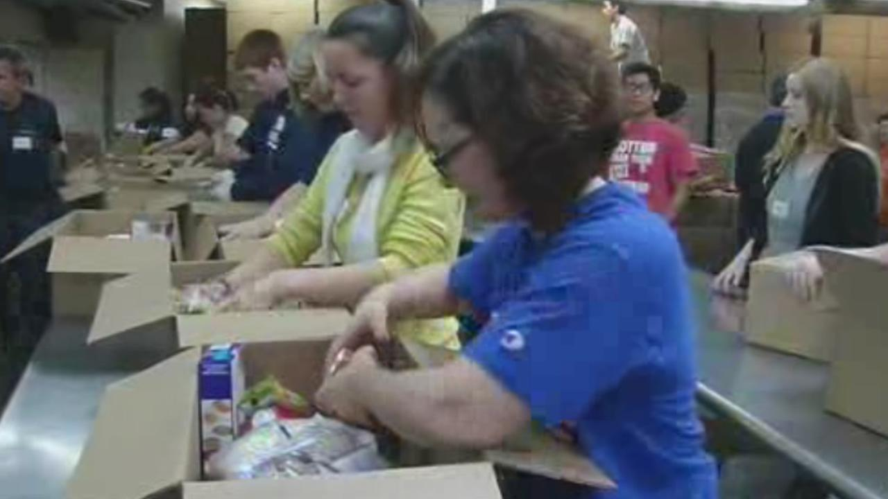 Hundreds of volunteers at Sacred Heart in San Jose, Calif., prepare boxes of food to be distributed to needy families for Thanksgiving on Saturday, Nov. 21, 2015.