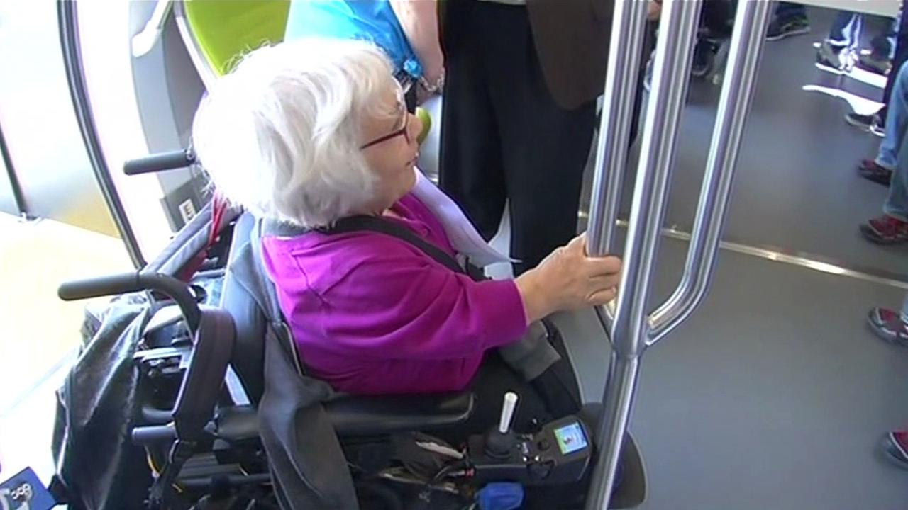 New BART train with person in wheelchair.