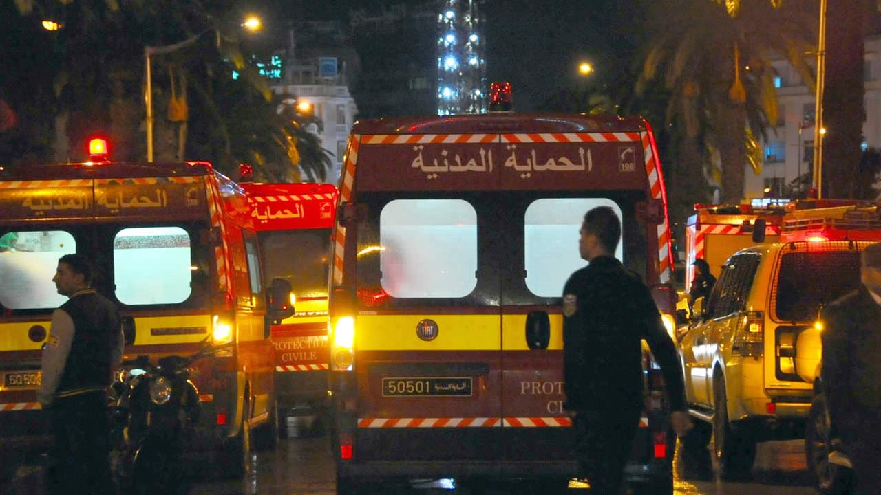 Ambulances and police vans are seen at the scene of a bus explosion in the center of the capital, Tunis, Tunisia, Tuesday, Nov. 24, 2015.
