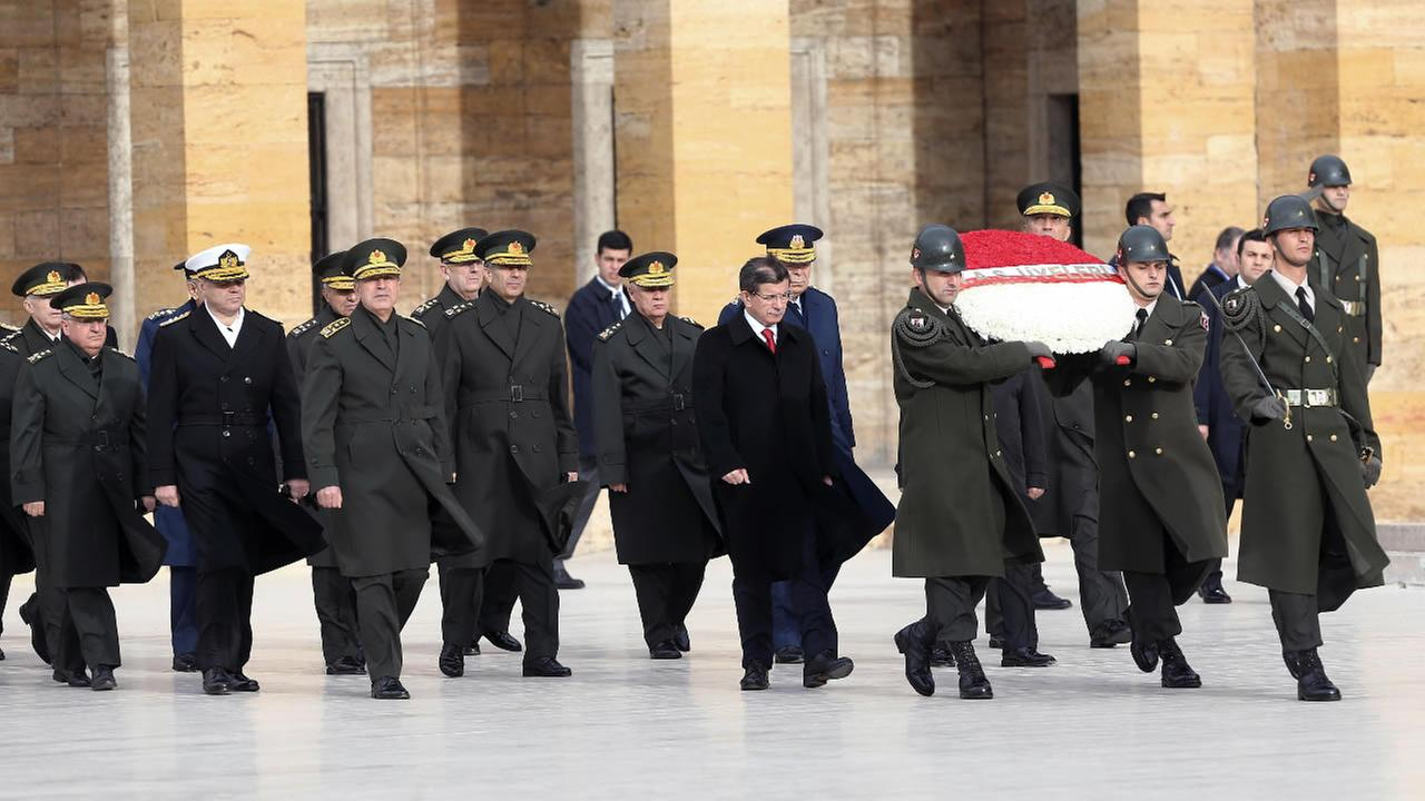 Turkish PM Davutoglu, center-right, and army commanders walk to the mausoleum of Turkeys founder Ataturk before a military meeting in Ankara, Turkey, Thursday, Nov. 26, 2015.