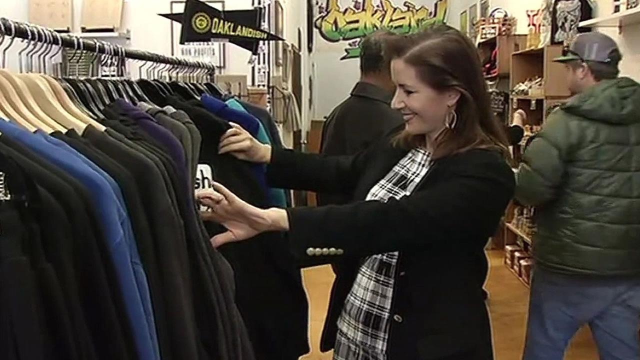 Oakland Mayor Libby Schaaf dressed in plaid shops at local business