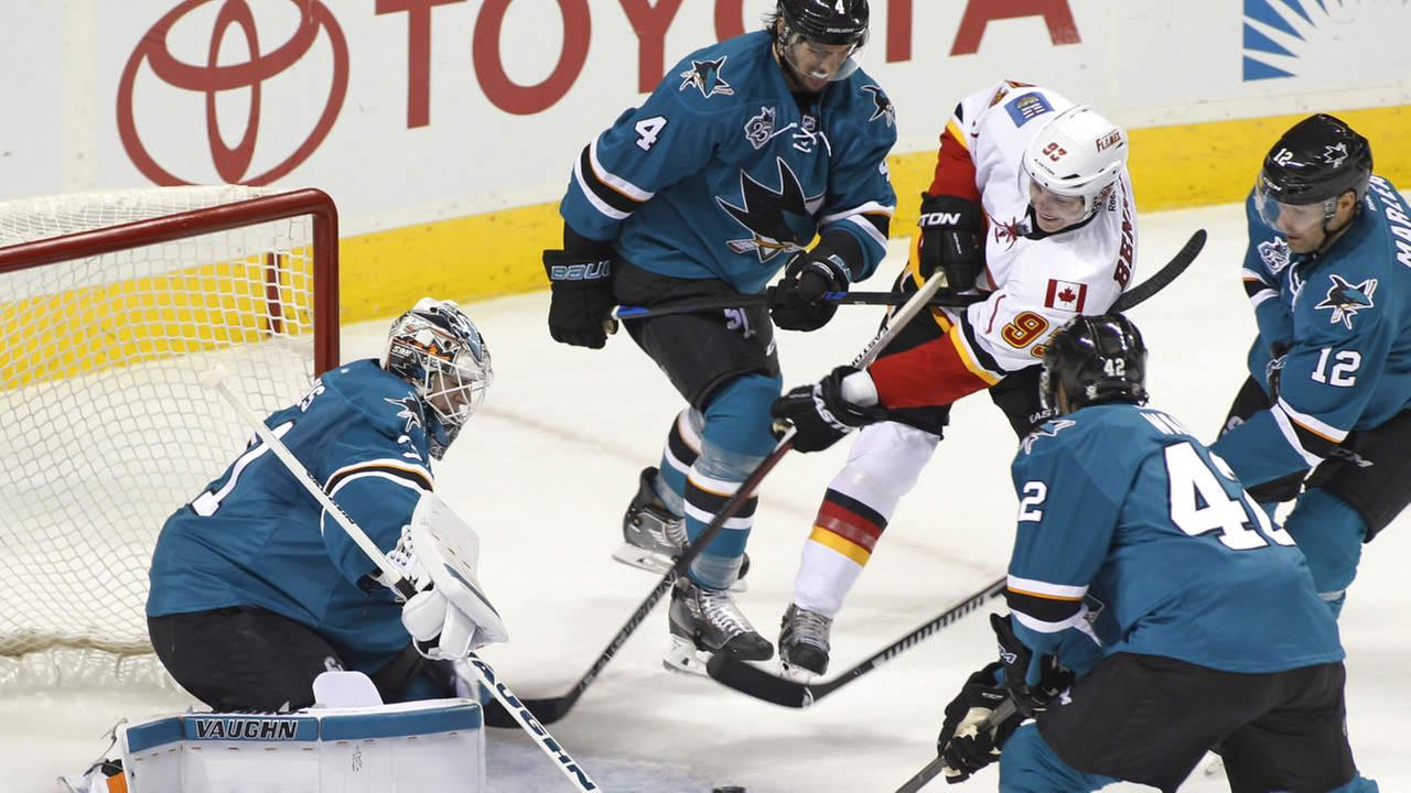 Calgary Flames Sam Bennett shoots as San Jose Sharks goalie Martin Jones defends during the third period of an NHL hockey game, Saturday, Nov. 28, 2015, in San Jose, Calif.