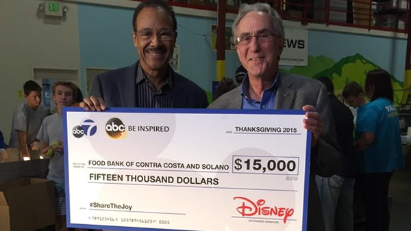 "<div class=""meta image-caption""><div class=""origin-logo origin-image none""><span>none</span></div><span class=""caption-text"">On behalf of ABC7 and Disney, Spencer Christian is seen giving a check to the executive director of the Food Bank of Contra Costa County and Solano in Concord on November 3, 2015. (@foodbankccs/Twitter)</span></div>"
