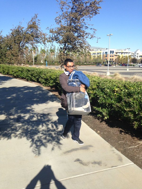 """<div class=""""meta image-caption""""><div class=""""origin-logo origin-image none""""><span>none</span></div><span class=""""caption-text"""">In this image, a UC Merced student is seen carrying away personal belongs following a stabbing that occurred on Wednesday, November 4, 2015. (@corinhoggard/Twitter)</span></div>"""