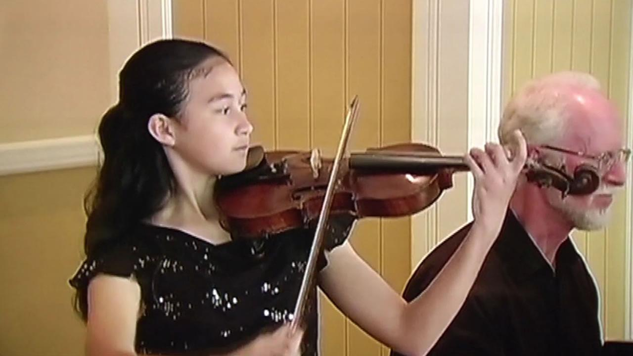 This photo shows Erica Buonanno playing the stolen violin at a recital several years ago.
