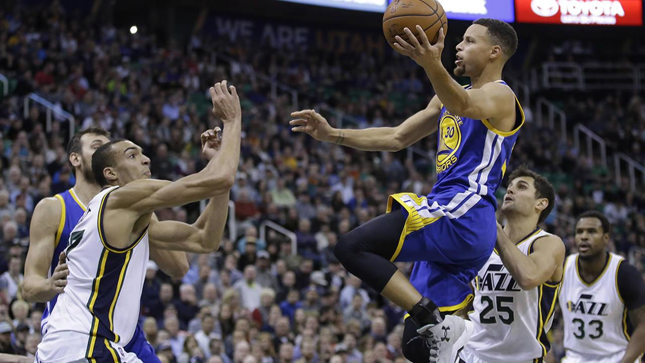 Golden State Warriors guard Stephen Curry jumps