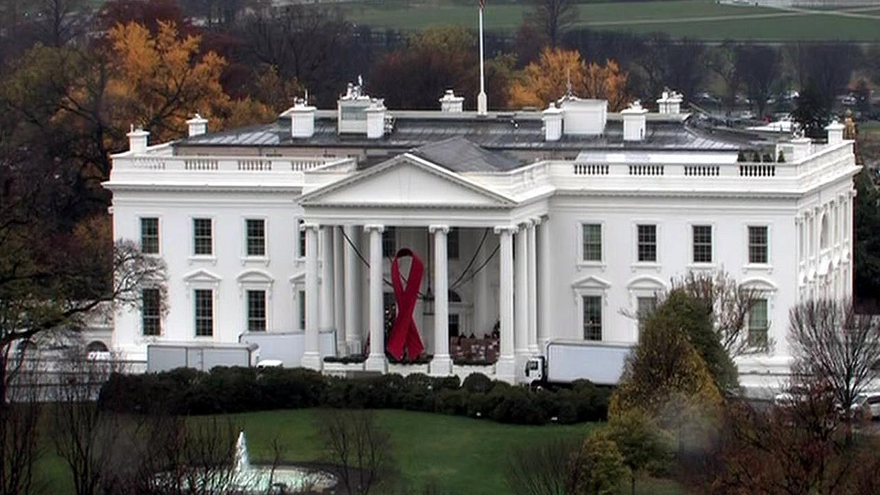 The White House is displaying a large, red ribbon on Tuesday, December 1, 2015 to mark World AIDS Day.