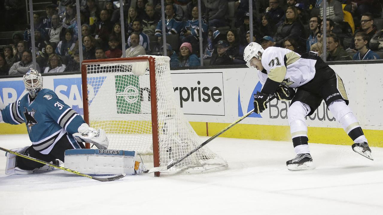 Pittsburgh Penguins Evgeni Malkin (71) scores past San Jose Sharks goalie Martin Jones during the second period of an NHL hockey game Tuesday, Dec. 1, 2015, in San Jose, Calif.