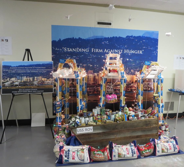 """<div class=""""meta image-caption""""><div class=""""origin-logo origin-image """"><span></span></div><span class=""""caption-text"""">STANDING FIRM AGAINST HUNGER: The Alameda County Registrar of Voters recreated the Port of Oakland with 556 pounds of food donations.</span></div>"""