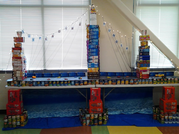 """<div class=""""meta image-caption""""><div class=""""origin-logo origin-image """"><span></span></div><span class=""""caption-text"""">suspENDING HUNGER: The display consists of canned and boxed goods totaling 639 pounds. </span></div>"""