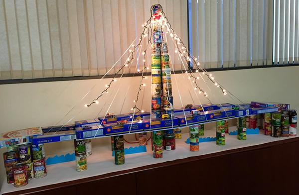 """<div class=""""meta image-caption""""><div class=""""origin-logo origin-image """"><span></span></div><span class=""""caption-text"""">BRIDGING THE GAP TO END HUNGER: The  Alameda  County  Assessor's  Office  worked  together  to  collect 164.19 pounds of canned and boxed goods to build this bridge.</span></div>"""