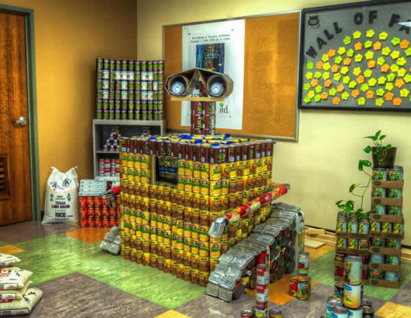 """<div class=""""meta image-caption""""><div class=""""origin-logo origin-image """"><span></span></div><span class=""""caption-text"""">WALL-E: Wall-E's creativity for building structures out of cans represents a fun way in dealing with a serious issue.  Structure made from 2222.50 lbs.</span></div>"""