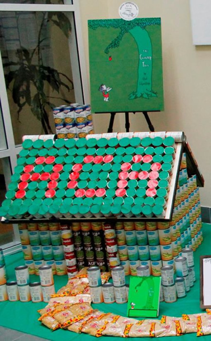 """<div class=""""meta image-caption""""><div class=""""origin-logo origin-image """"><span></span></div><span class=""""caption-text"""">THE GIVING TREE: The Auditor-Controller Agency has brought a childhood story of reciprocal giving to life.  The display has 1,120 pounds of food.</span></div>"""