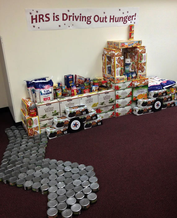 """<div class=""""meta image-caption""""><div class=""""origin-logo origin-image """"><span></span></div><span class=""""caption-text"""">DRIVING OUT HUNGER : This display was built with 910 lbs. of food pounds of food.</span></div>"""