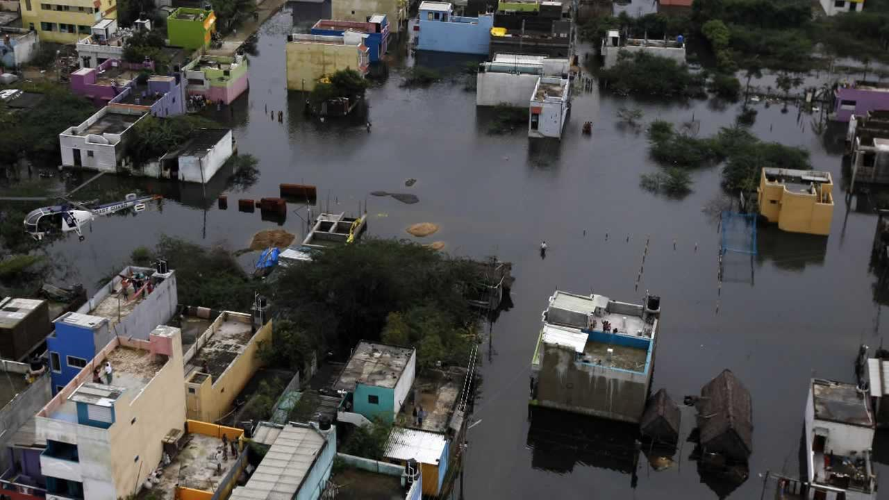 A residential area is seen surrounded by floodwaters in Chennai, India, Saturday, Dec. 5, 2015.