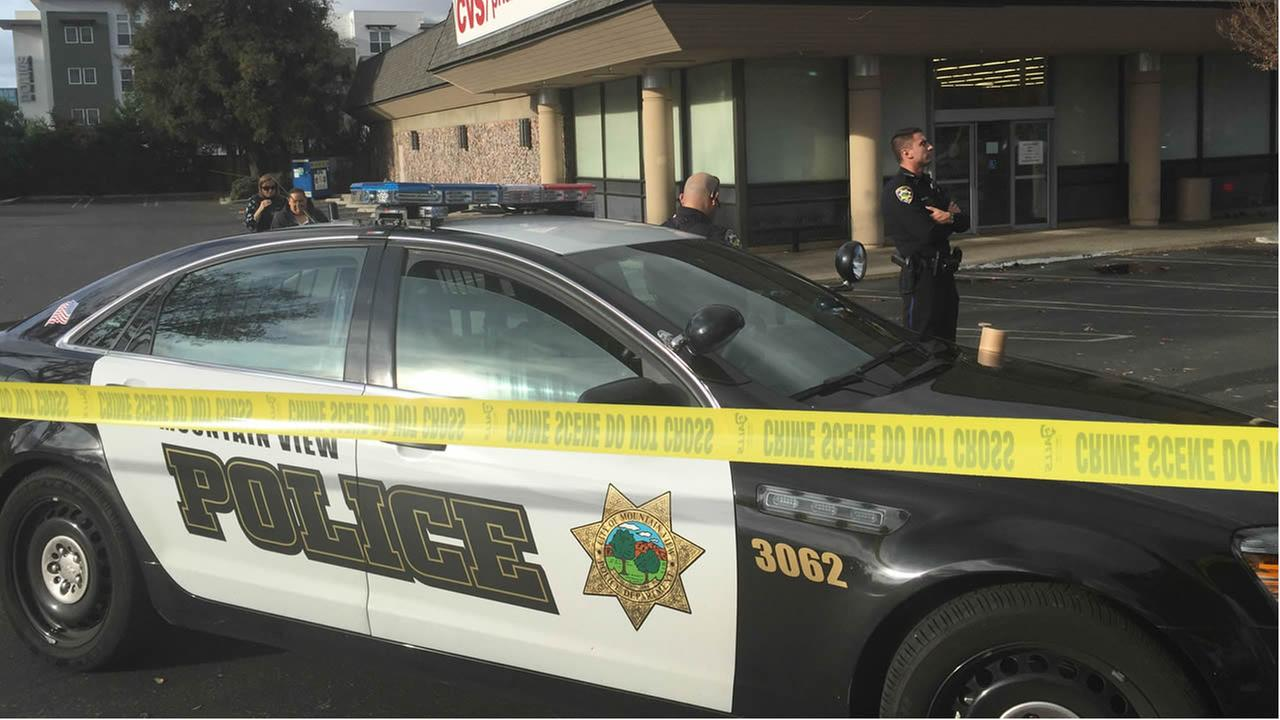 Officials investigate a suspicious package in front of a CVS on 2630 West El Camino Real in Mountain View, Calif. on Sunday December 6, 2015.