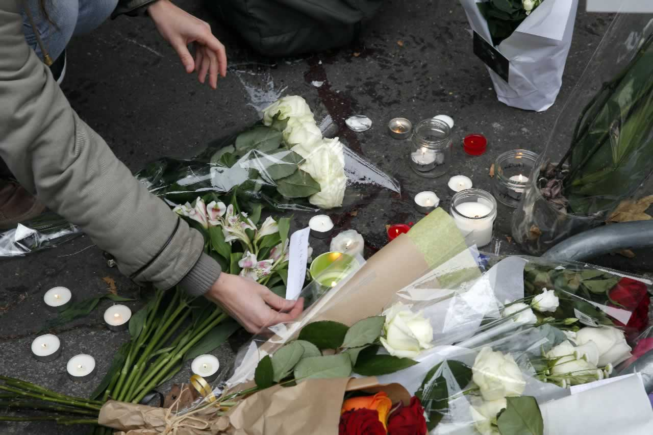 "<div class=""meta image-caption""><div class=""origin-logo origin-image none""><span>none</span></div><span class=""caption-text"">A woman places a candle and reads a message outside the Bataclan concert hall, Saturday, Nov. 14, 2015 in Paris.  (AP Photo/Christophe Ena)</span></div>"