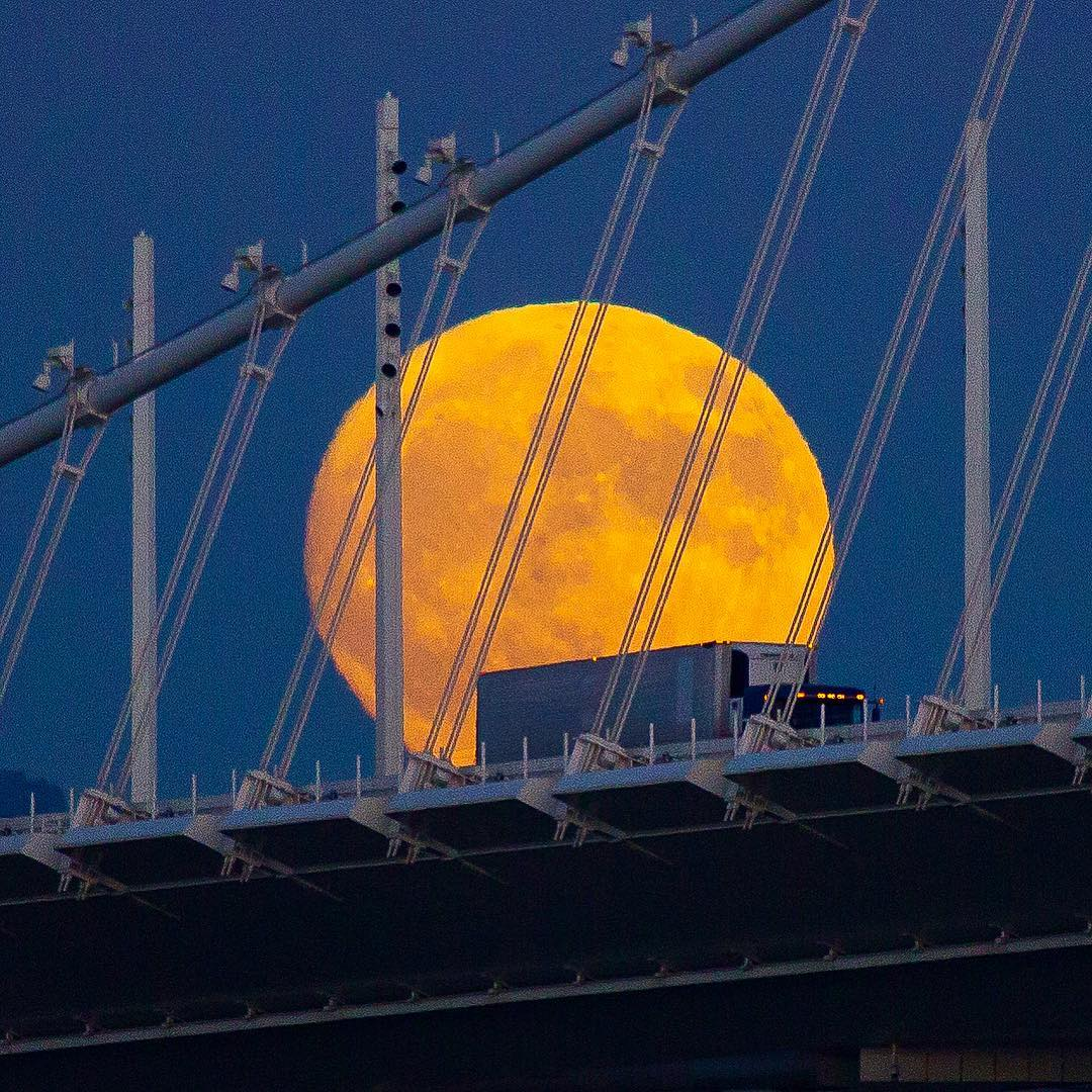 "<div class=""meta image-caption""><div class=""origin-logo origin-image none""><span>none</span></div><span class=""caption-text"">The supermoon is seen behind a truck driving across the Bay Bridge on Nov. 13, 2016. (Instagram/louisraphael)</span></div>"