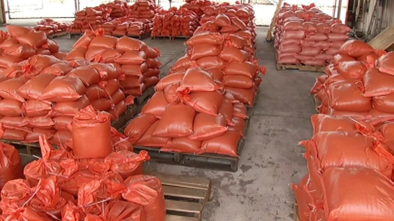 orange sandbags ready to be given out