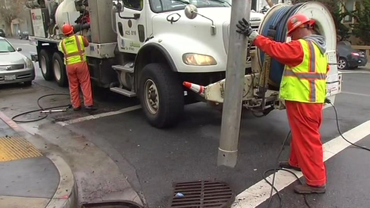 San Francisco city crews clear storm drains