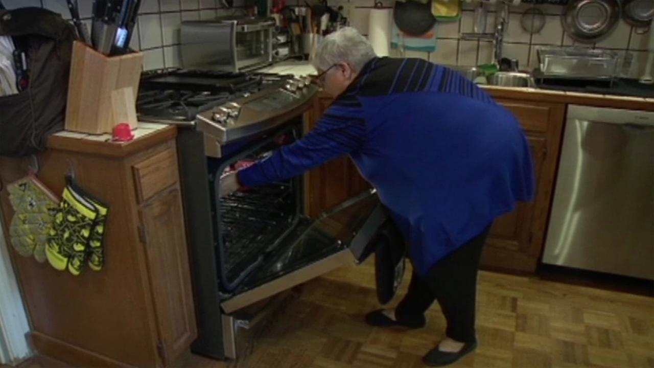 This undated photo shows Deborah McAuliffe checking the oven in her home.