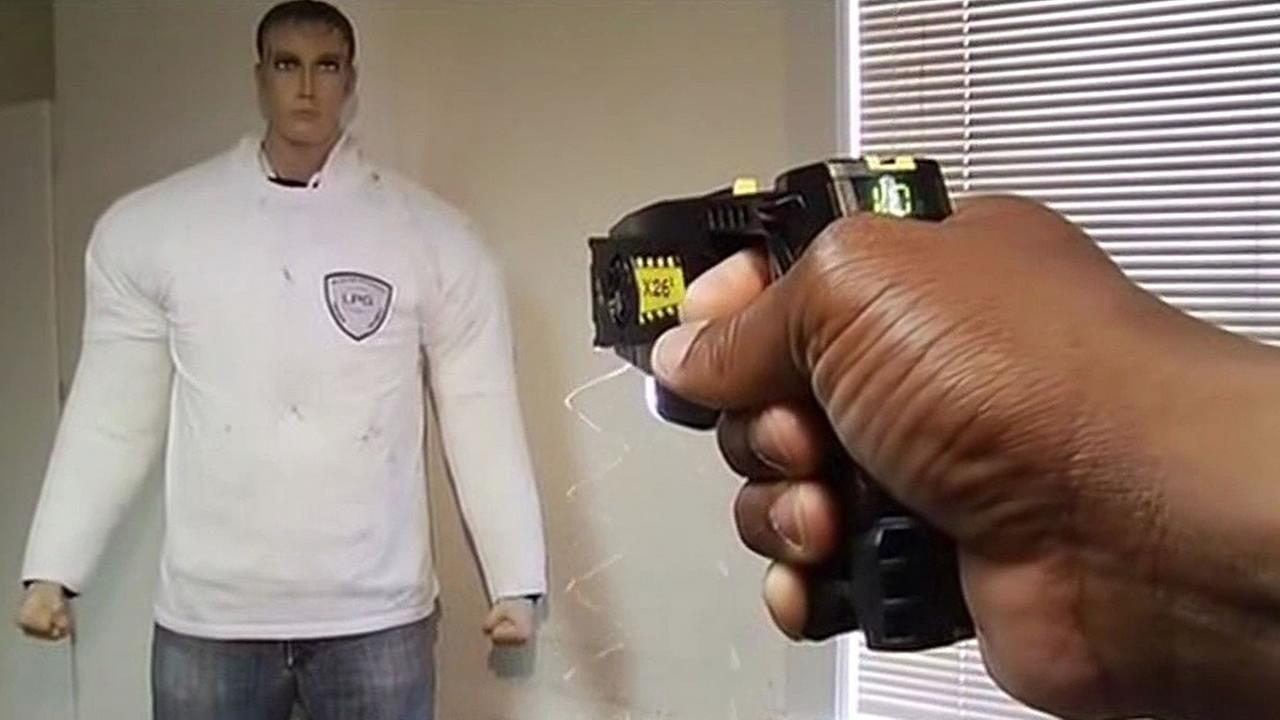 police using a Taser on a dummy