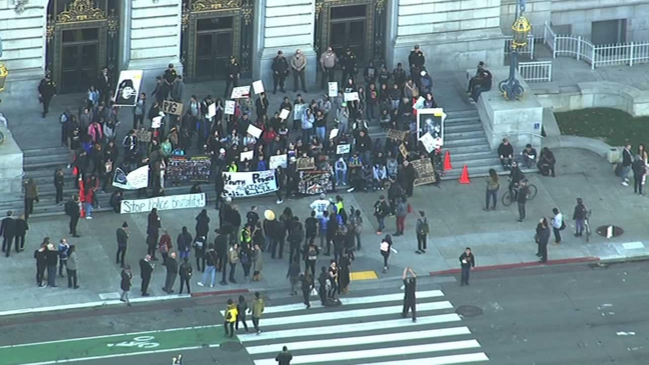 Demonstrators protesting the shooting death of Mario Woods by multiple officers marched through downtown San Francisco, stopping at City Hall, on Friday, December 11, 2015.KGO-TV