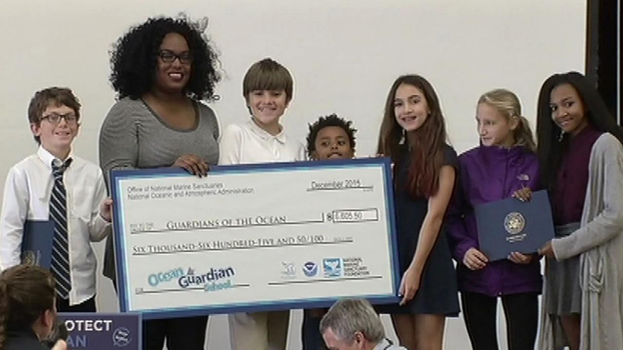 Second graders at Pakland School with a big check