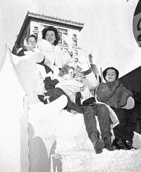 <div class='meta'><div class='origin-logo' data-origin='none'></div><span class='caption-text' data-credit='AP Photo/HVN'>Former child film star Shirley Temple and her children Ride a float in the Annual Thanksgiving Day parade on Nov. 26, 1959 in New York.</span></div>
