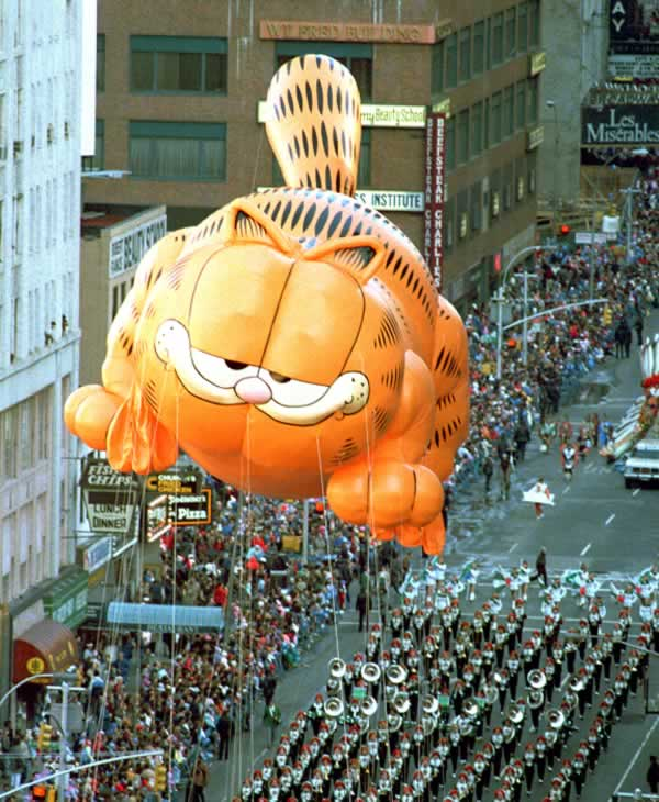 <div class='meta'><div class='origin-logo' data-origin='none'></div><span class='caption-text' data-credit='AP Photo/Ron Frehm'>Garfield the Cat floats above a marching band on Broadway in the Macy's Thanksgiving Day parade in New York City, Thursday, Nov. 27, 1986.</span></div>