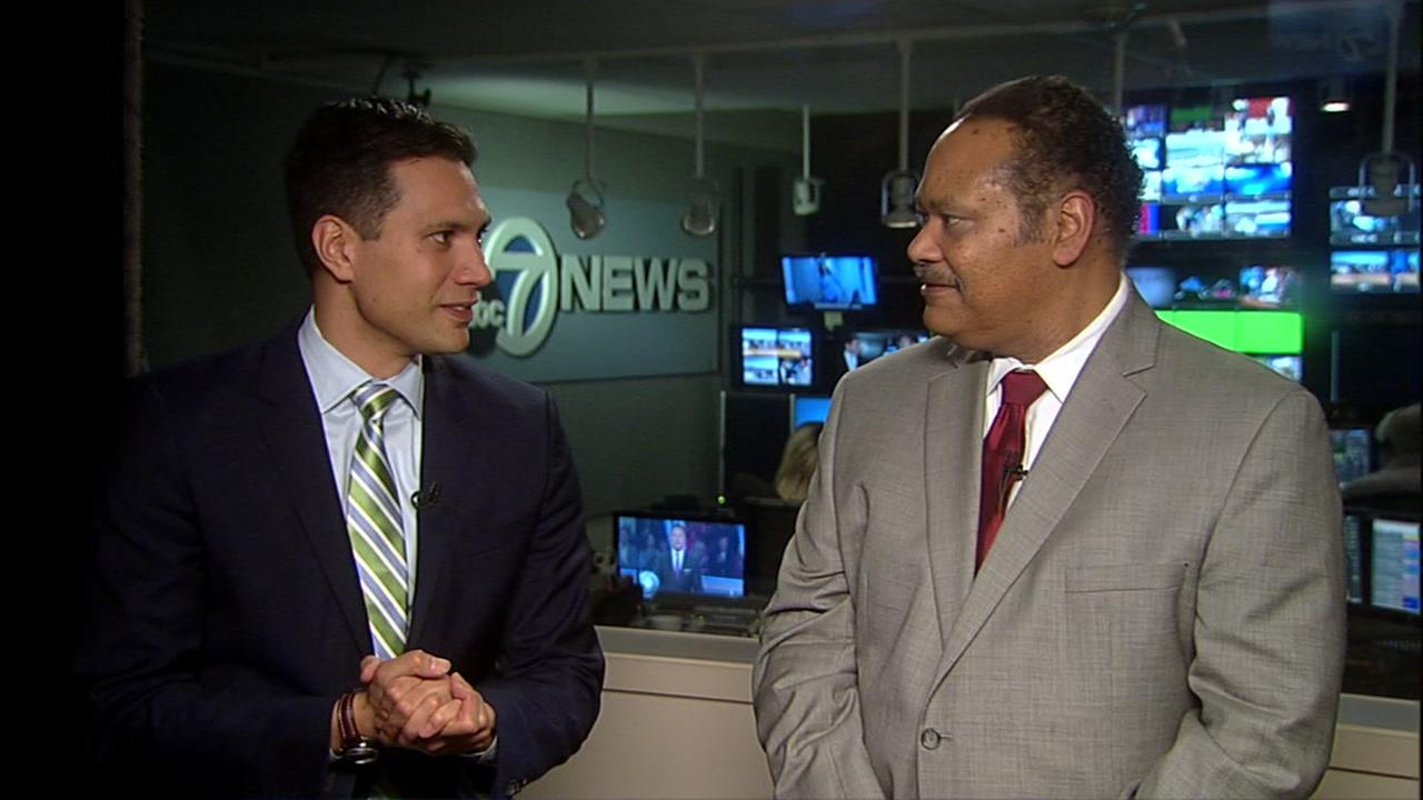 ABC7s veteran anchor Eric Thomas talks to newcomer Reggie Aqui in San Francisco on Wednesday, December 16, 2015.