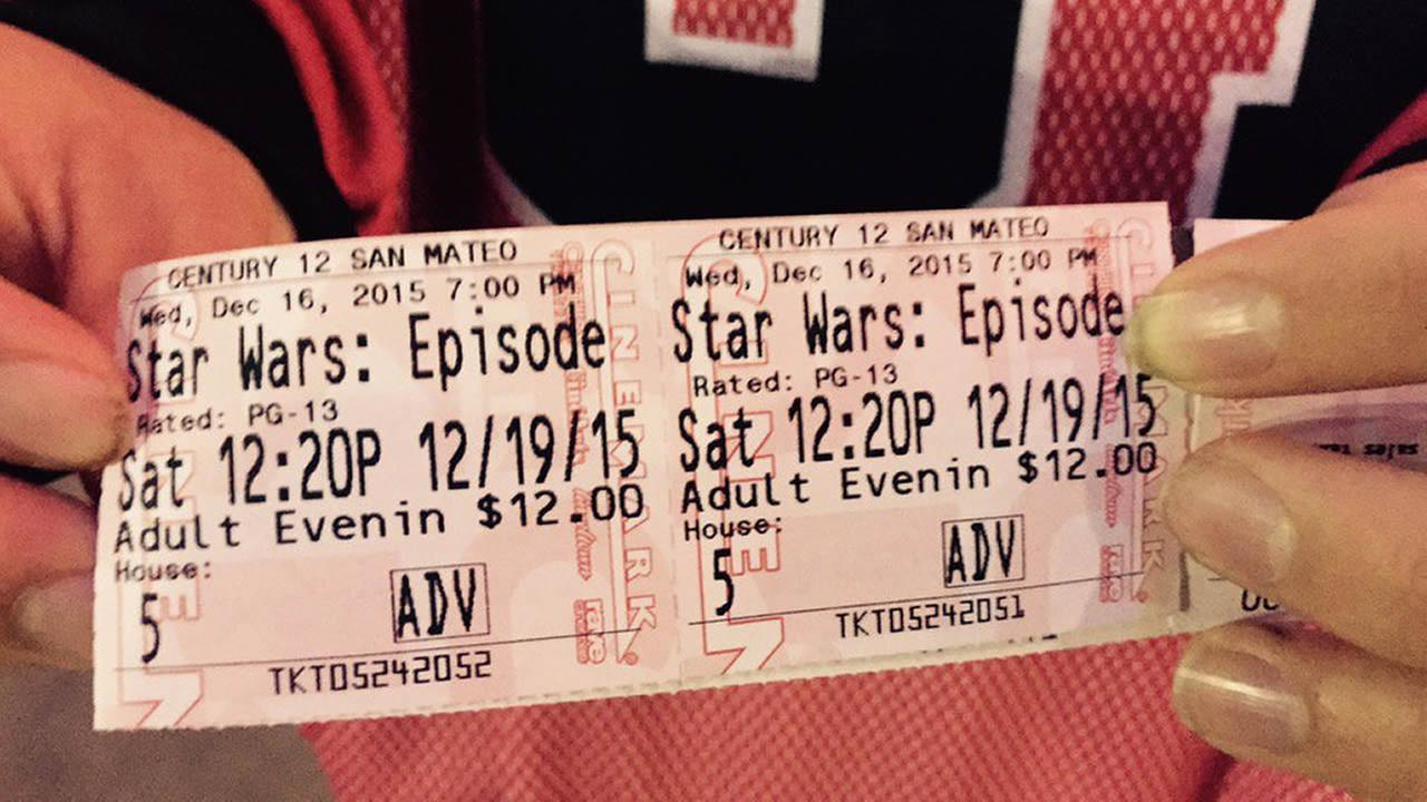 An excited Star Wars fan shows off movie tickets in San Mateo, Calif. on Thursday, December 16, 2015.