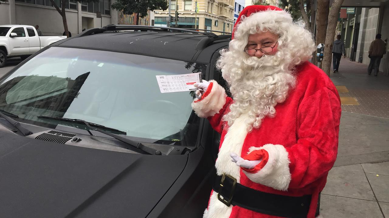 Santa Claus got a parking ticket while handing out toys at a school in San Francisco on Friday, December 18, 2015.