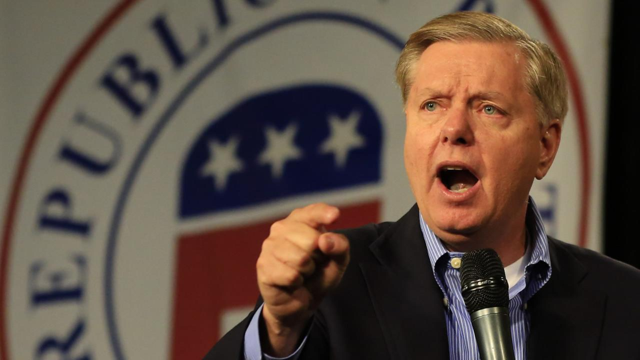 FILE: Republican presidential candidate, Sen. Lindsey Graham, R-S.C., speaks at the Iowa GOPs Growth and Opportunity Party at the Iowa state fair grounds in Des Moines, Iowa.