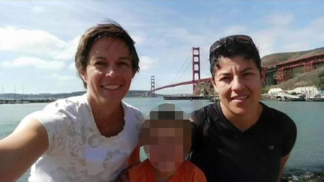 U.S. Air Force Major Adrianna Vorderbruggen, right, is shown in a photo with her wife, Heather Lamb, left, and their 4-year-old son in San Francisco.