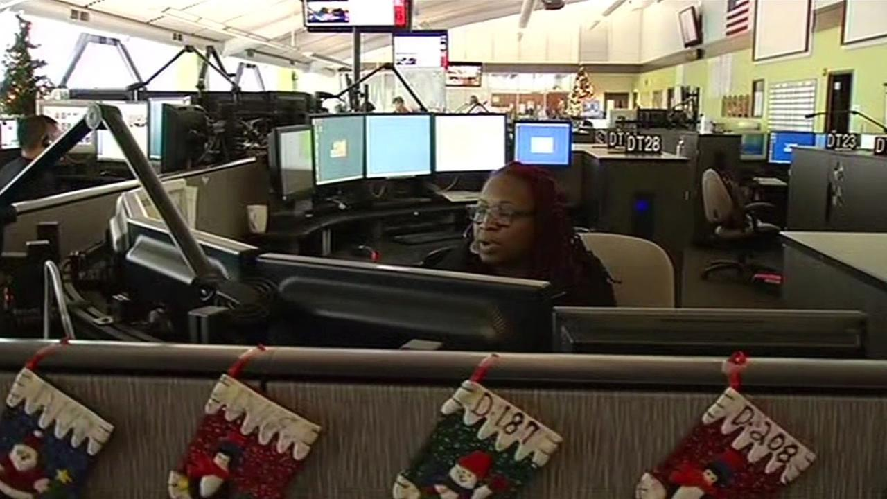 A 911 dispatcher in San Franciscos Office of Emergency Management answers calls  Dec. 23, 2015.