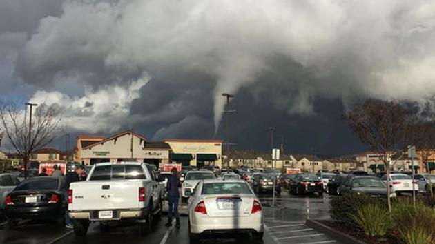 A possible funnel cloud was spotted at a Raleys parking lot in Folsom, Calif. Dec. 24, 2015.