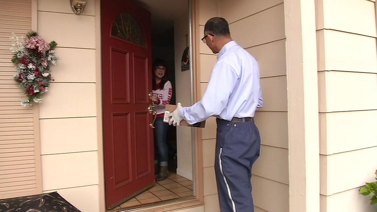 postal carrier delivers a package