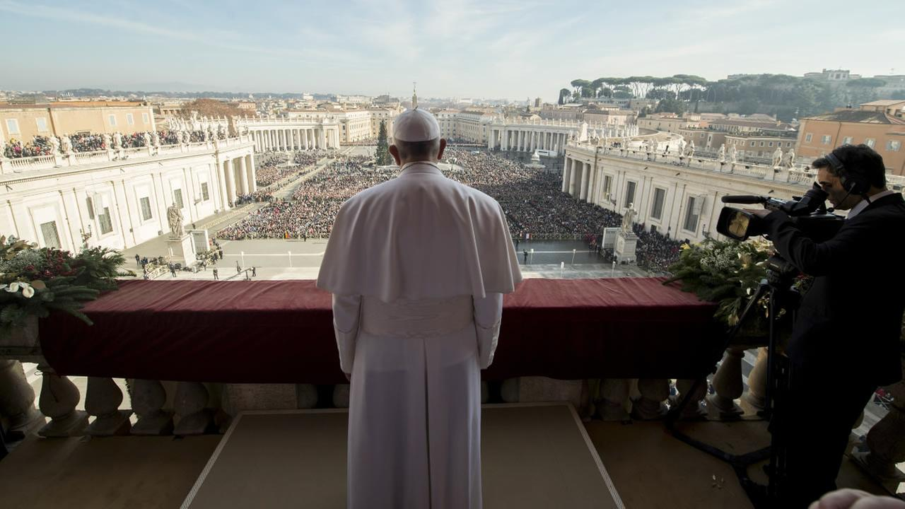 Pope Francis delivers his Urbi et Orbi (to the city and to the world) blessing from the central balcony of St. Peters Basilica at the Vatican, Friday, Dec. 25, 2015.