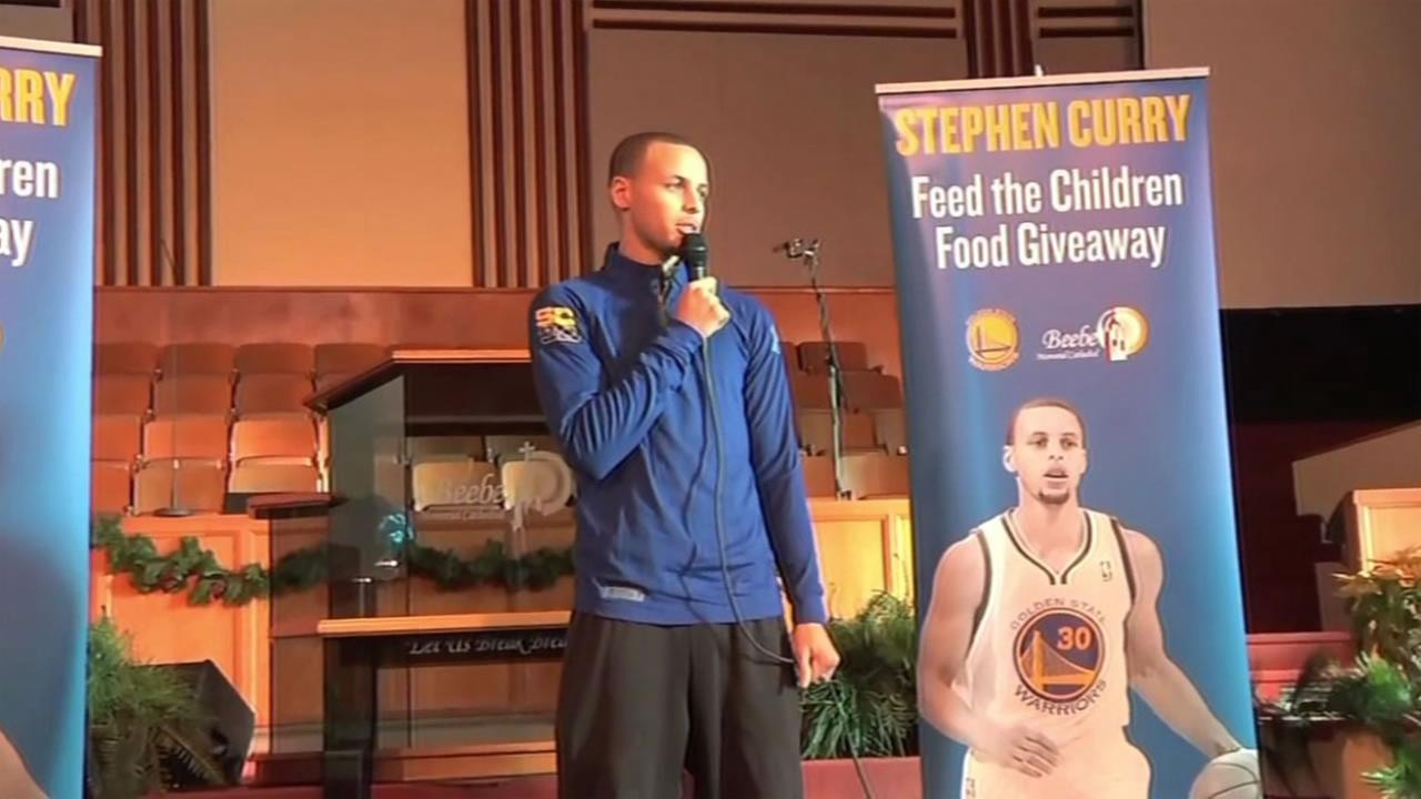 Stephen Curry speaks before delivering food to hundreds of hungry families in Oakland, Calif. on Saturday, December 26, 2015.