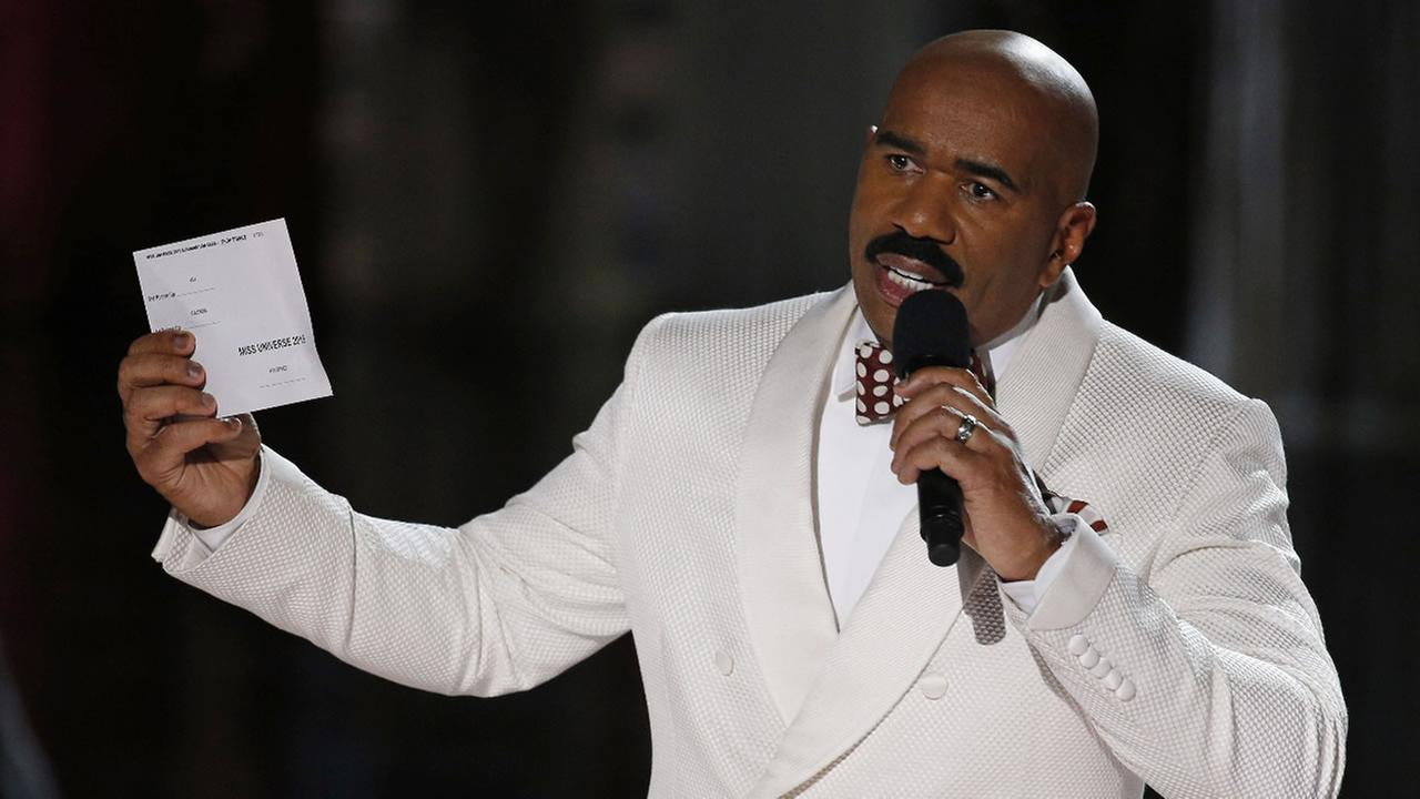 Steve Harvey holds up the card showing the winners after he incorrectly announced Miss Colombia Ariadna Gutierrez at the winner at the Miss Universe pageant Sunday, Dec. 20, 2015, in Las Vegas.