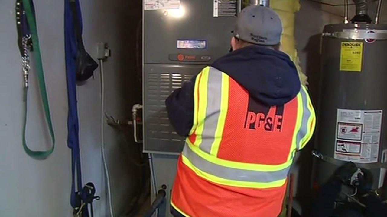 PG&E worker lighting a pilot light in Discovery Bay