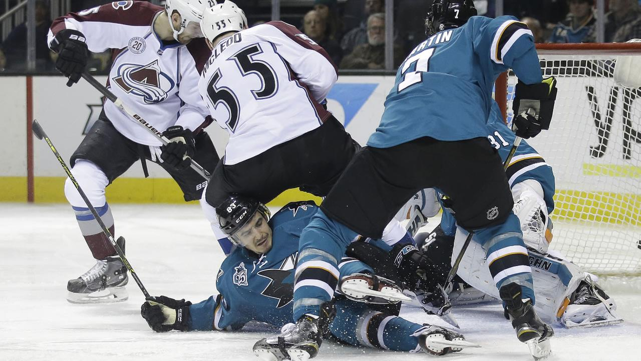 San Jose Sharks Matt Nieto, bottom, gets tangled with Colorado Avalanches Cody McLeod (55) during an NHL hockey game Monday, Dec. 28, 2015, in San Jose. Calif..