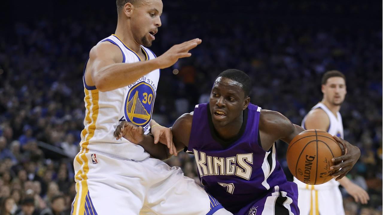 Warriors Stephen Curry and Kings Darren Collison
