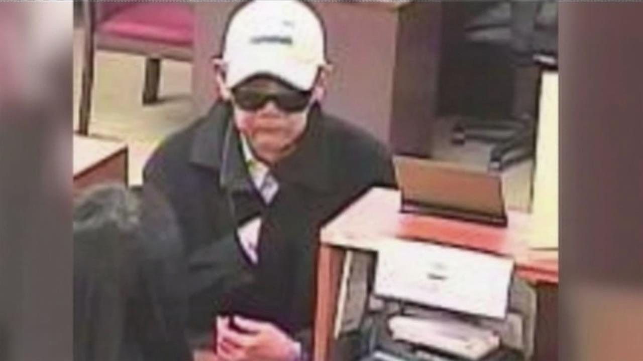 The FBI has released surveillance images of the bank robber nicknamed droopy-faced bandit who is wanted for robbing several banks in San Francisco.