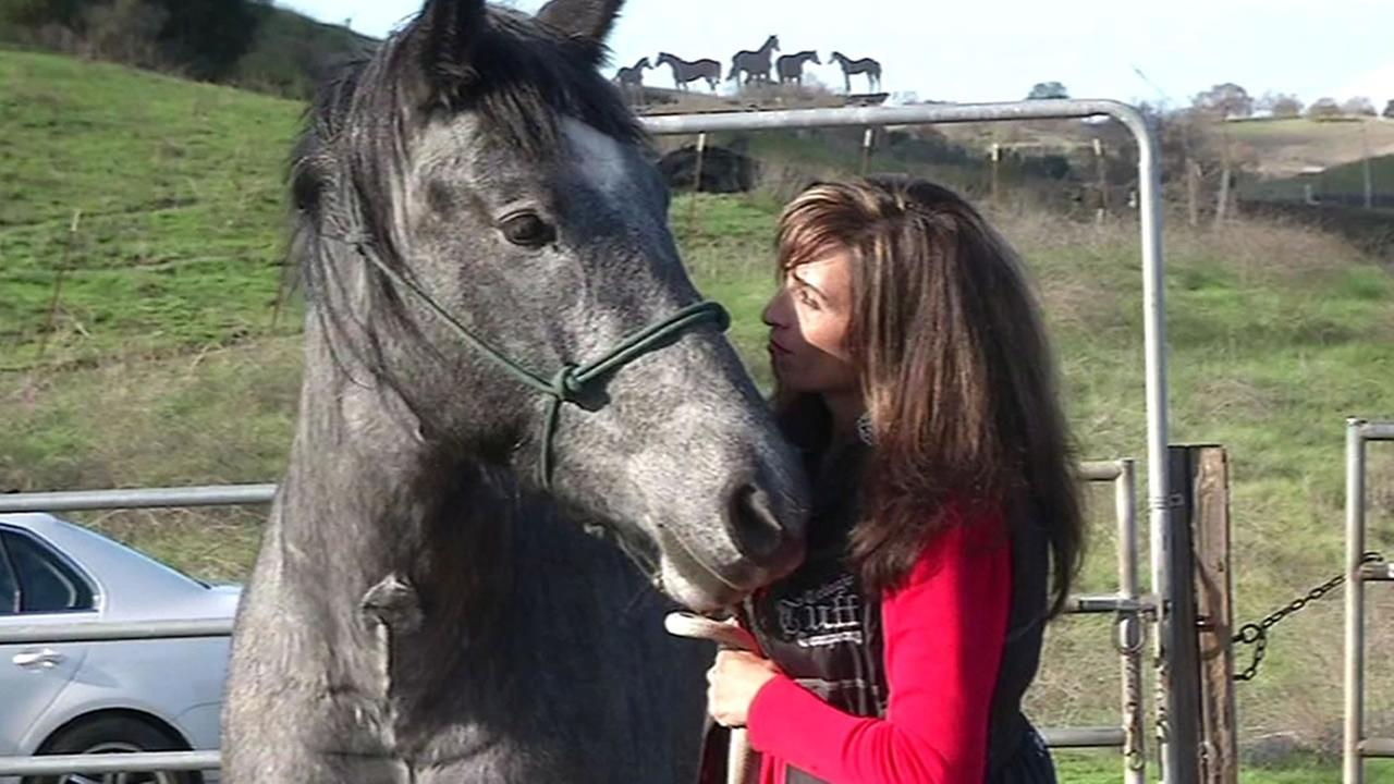 Equine Rescue Center founder Monica Hardeman and a horse