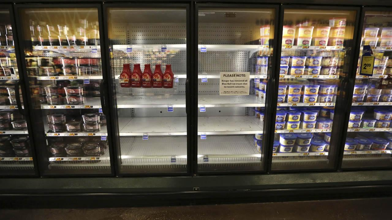 Shelves sit empty of Blue Bell ice cream at a grocery store in Dallas, Tuesday, April 21, 2015.