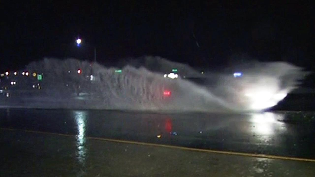 Car drives through flooding on Highway 101 in Marin County, Tuesday, January 5, 2016.KGO-TV