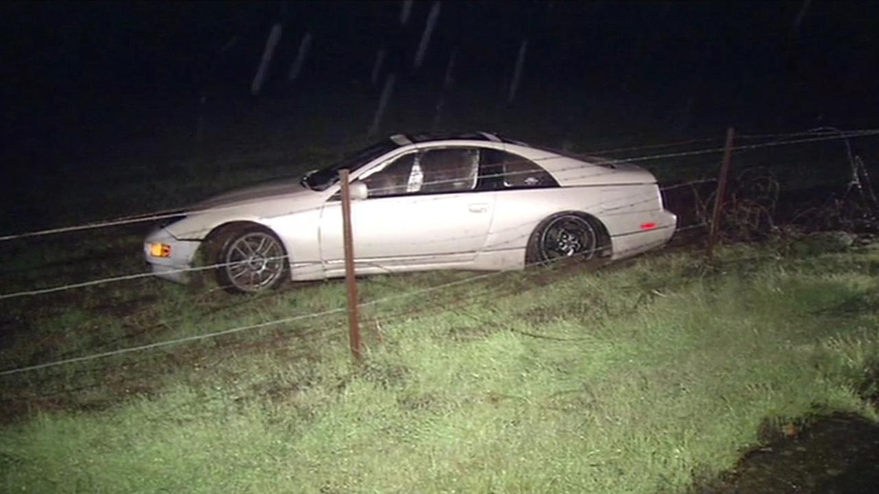 This photo shows a car  that slid off the road along Novato Boulevard in Novato, Calif. on Monday, January 4, 2016.KGO-TV